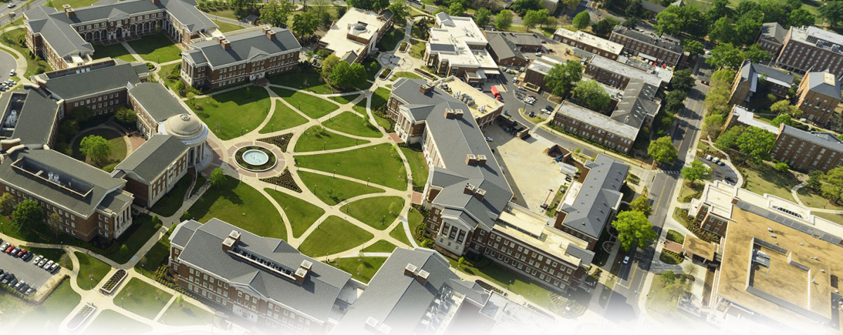 Background image of the UA campus from above.